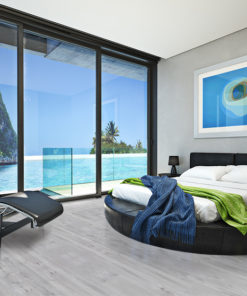 barn wood cork flooring modern bedroom with a view of a magnificent seaside ocean cove photo