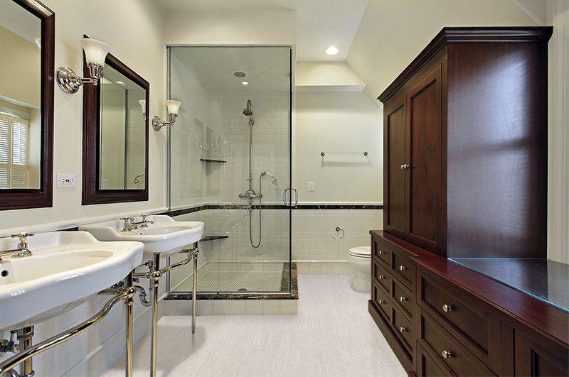 bleached birch cork floor master bath in luxury home with glass shower