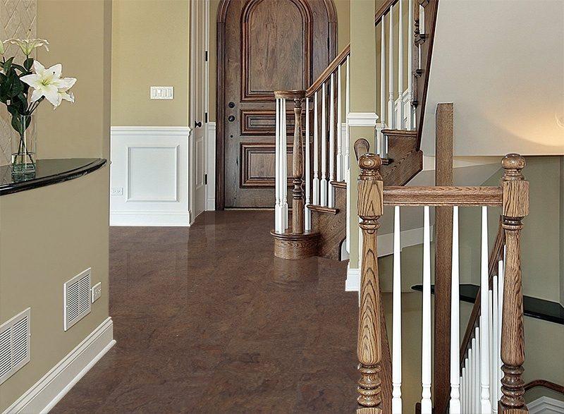 brown salami cork flooring entryway foyer showing front door