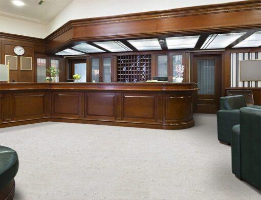 ceramic marble cork flooring interior of a hotel lobby with reception desk