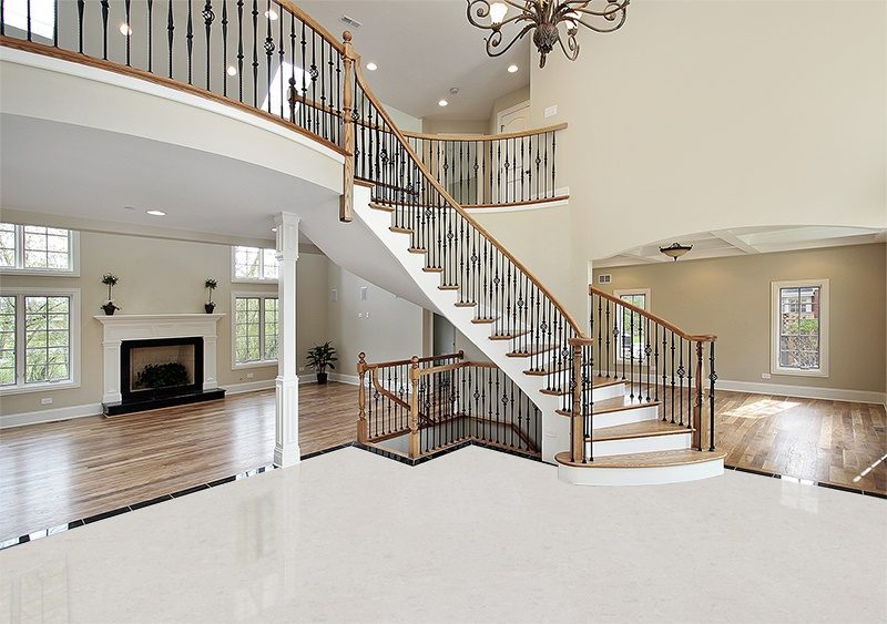 creme royal marble white cork floors foyer curved staircase wood luxury home