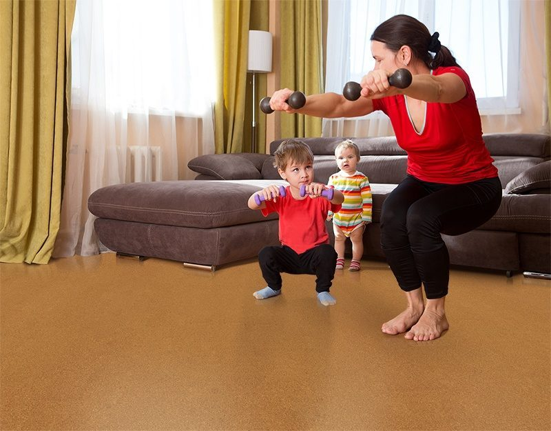 golden bach cork floor exercising together happy mother son dumbbell