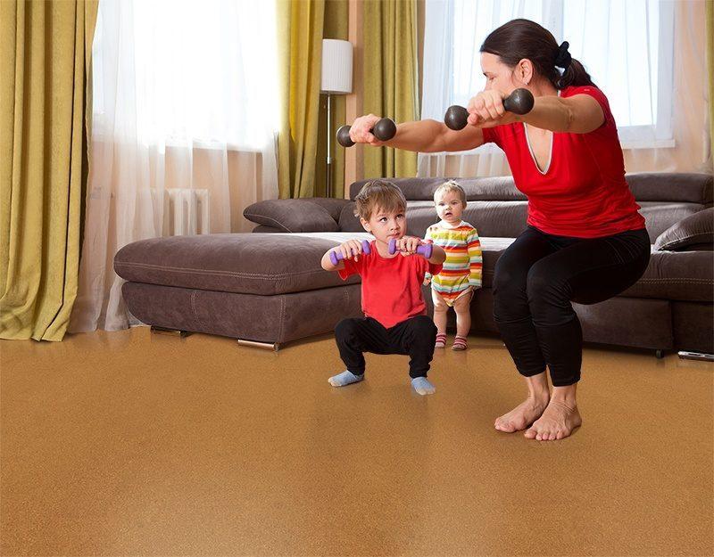 golden bach cork floor exercising together happy mother son dumbbell