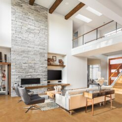 logan beautiful living room with foran cork floors and fireplace in new luxury home