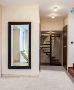 marble cork flooring under brown stairs off white wall modern home