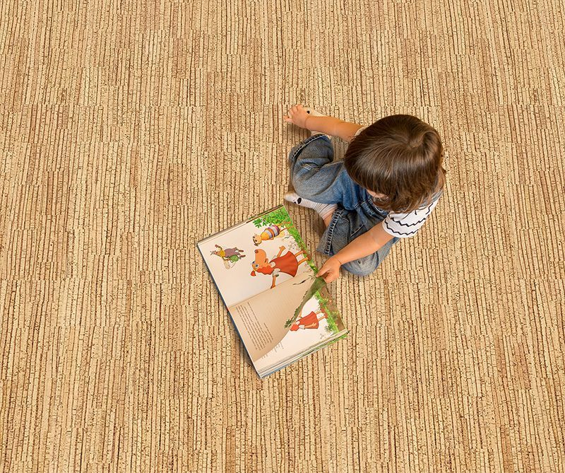 sisal cork floor girl reading book at kindergarten