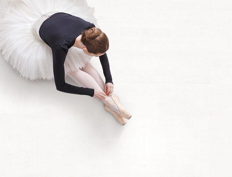 white leather cork flooring ballet dancer practice stretching